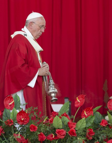 Pope Francis circles the altar with incense during a Mass in the Plaza of the Revolution, in Holguin, Cuba, Monday, Sept. 21, 2015. Speaking in his homily Francis called on Cubans to heed Jesus Christ's invitation to overcome resistance to change. Francis is the first pope to visit Holguin, Cuba's third-largest city. (AP Photo/Alessandra Tarantino)