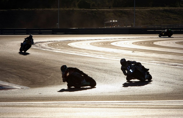 Competitors compete, during the 79th Bol d'Or Endurance motorcycle race at the Paul Ricard circuit, in Le Castellet, near Marseille, southern France, Sunday, Sept. 20, 2015. (AP Photo/Claude Paris)