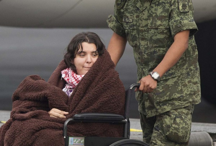 A Mexican woman wounded in an attack by the Egyptian army while traveling in Egypt, is transferred from her return flight to a waiting helicopter at the presidential hangar of Benito Juarez International Airport in Mexico City, Friday, Sept. 18, 2015. Eight other Mexicans died Sunday when Egyptian forces hunting militants mistakenly attacked their convoy in the western desert. Four other people died in the attack on the convoy, which was led by Egyptian guides. Their nationalities were not confirmed.  || CREDIT: REBECCA BLACKWELL - AP PHOTO