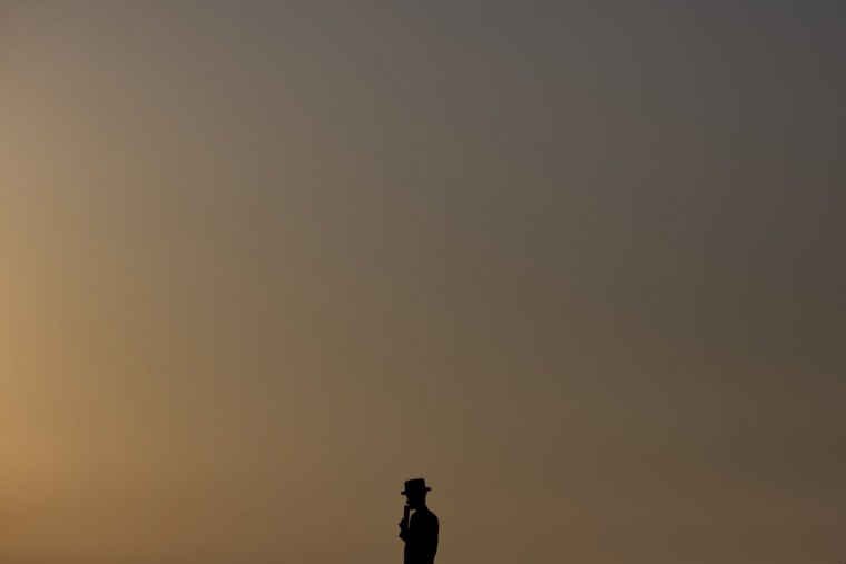 """An ultra-Orthodox Jewish man of the Hassidic sect Vizhnitz prays on a hill overlooking the Mediterranean Sea as they participate in a Tashlich ceremony in Herzeliya, Israel, Monday, Sept. 21, 2015. Tashlich, which means """"to cast away"""" in Hebrew, is a practice in which Jews go to a large flowing body of water and symbolically """"throw away"""" their sins by throwing a piece of bread, or similar food, into the water before the Jewish holiday of Yom Kippur, which start on Tuesday at sundown. (AP Photo/Ariel Schalit)"""