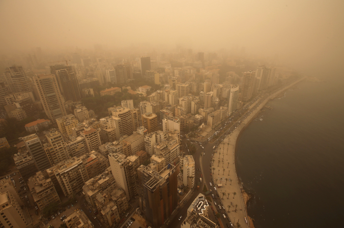 A sandstorm shrouds the capital city of Beirut, Lebanon, on Tuesday. The unseasonal sandstorm hit Lebanon and Syria, reducing visibility and sending dozens to hospitals with breathing difficulties because of the fine dust. (Hussein Malla/AP)