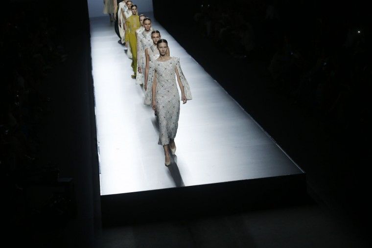 Models display creations designed by Teresa Helbig, part of the 2016 Spring/Summer collection, at the Madrid's Fashion Week in Madrid, Spain, Sunday, Sept. 20, 2015. (AP Photo/Francisco Seco)