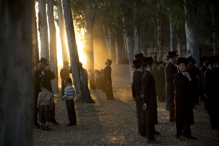 "Ultra-Orthodox Jews gather by the Yarkon springs as they participate in a Tashlich ceremony near Rosh Haain, central Israel, Monday, Sept. 21, 2015. Tashlich, which means ""to cast away"" in Hebrew, is a practice in which Jews go to a large flowing body of water and symbolically ""throw away"" their sins by throwing a piece of bread, or similar food, into the water before the Jewish holiday of Yom Kippur, which starts on Tuesday. (AP Photo/Oded Balilty)"
