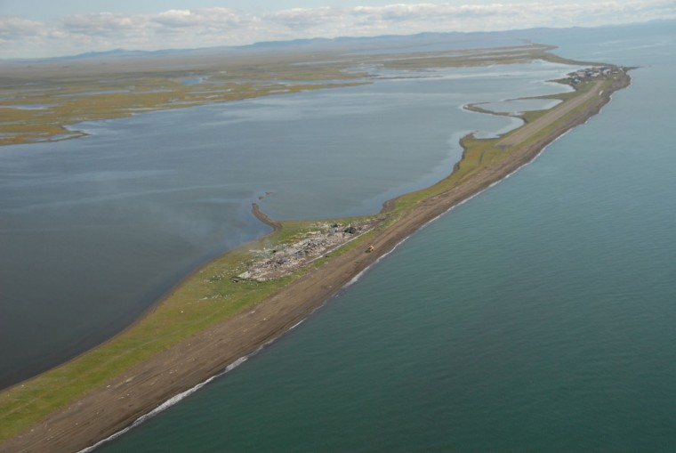 This Aug. 7, 2008 aerial file photo shows the barrier island on which the village of Kivalina is located near Anchorage, Alaska. It stretches along the edge of the Chukchi Sea.. Residents of Kivalina, one of Alaska's most eroded villages, are thankful for President Barack Obama's attention to their plight during his visit to the state this week, saying they hope it will help them secure funding to build an evacuation road to drier ground, Wednesday, Sept. 2, 2015 (Bob Hallinen/The Anchorage Daily News via AP, File)