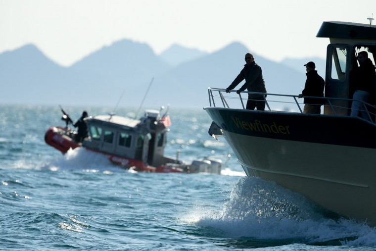 President Barack Obama stops at Thumb Cove to look at three glaciers while taking a boat tour to see the effects of global warming in Resurrection Cove, Tuesday, Sept. 1, 2015, in Seward, Alaska. Obama is on a historic three-day trip to Alaska aimed at showing solidarity with a state often overlooked by Washington, while using its glorious but changing landscape as an urgent call to action on climate change. (AP Photo/Andrew Harnik)