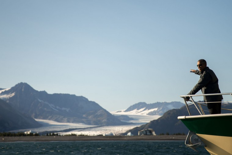 President Barack Obama looks at Bear Glacier, which has receded 1.8 miles in approximately 100 years, while on a boat tour to see the effects of global warming in Resurrection Cove, Tuesday, Sept. 1, 2015, in Seward, Alaska. Obama is on a historic three-day trip to Alaska aimed at showing solidarity with a state often overlooked by Washington, while using its glorious but changing landscape as an urgent call to action on climate change. (AP Photo/Andrew Harnik)