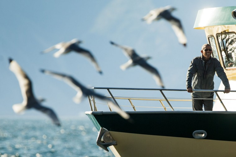 President Barack Obama stops to look at sea lions at Fox Island while taking a boat tour to see the effects of global warming in Resurrection Cove, Tuesday, Sept. 1, 2015, in Seward, Alaska. Obama is on a historic three-day trip to Alaska aimed at showing solidarity with a state often overlooked by Washington, while using its glorious but changing landscape as an urgent call to action on climate change. (AP Photo/Andrew Harnik)
