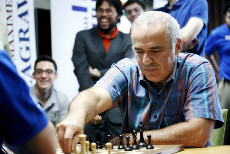 World chess legend Garry Kasparov makes a move during a series of rapid and blitz exhibition games called Ultimate Moves held following the 2015 Sinquefield Cup at the Chess Club and Scholastics Center of St. Louis on September 3, 2015, in St. Louis. (Photo by Erin Stubblefield/Invision for Chess Club and Scholastics Center of St. Louis/AP Images)