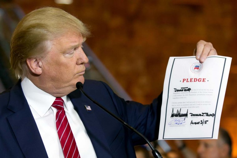 Republican presidential candidate Donald Trump looks at a signed pledge during a news conference in Trump Tower, Thursday, Sept. 3, 2015 in New York. Trump ruled out the prospect of a third-party White House bid and vowed to support the Republican Party's nominee, whoever it may be.  || CREDIT: RICHARD DREW - AP PHOTO