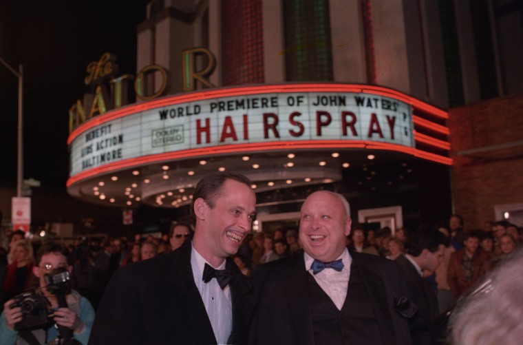 "February 16, 1988 - Baltimore director John Waters and drag queen Divine, aka Harris Glenn Milstead, share a light moment outside the Senator Theatre at the world premiere of ""Hairspray."" (Amy Davis/Baltimore Sun)"