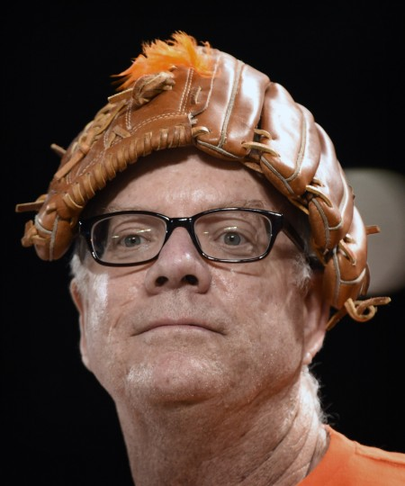 A fan carries his glove on his head during game. (Kenneth K. Lam/Baltimore Sun)