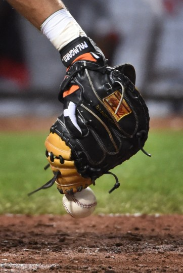 Orioles catcher Matt Wieters uses his Rawlings Gold-labelled mitt to catch a ball fouled by a batter.   (Kenneth K. Lam/Baltimore Sun)