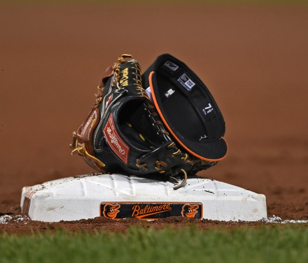 A teammate of Chris Davis left his glove and cap on the bag during inning change.  (Kenneth K. Lam/Baltimore Sun)