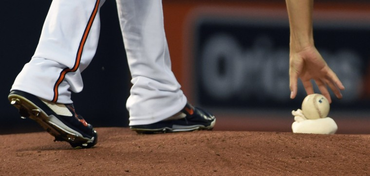 Orioles pitcher Kevin Gausman picks up the ball from the rosin bag on the mound to start a game.  (Kenneth K. Lam/Baltimore Sun)