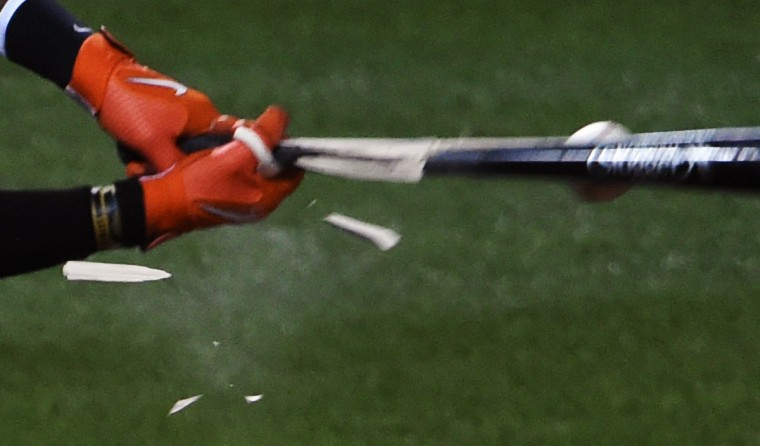 The bat of Orioles center-fielder Adam Jones breaks as it strikes a baseball at a weak spot during game against  the Red Sox.  (Kenneth K. Lam/Baltimore Sun)