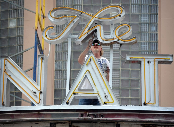 "Joe Belsinger, Belsinger Sign Works, Inc., paints a portion of ""The Senator"" sign on the historic York Road theatre. In addition to painting, the company will install lighted panels on the marquee. (Kim Hairston/Baltimore Sun)"