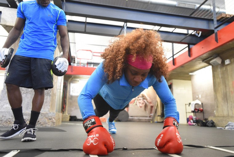 Franchon Crews does interval training with the help of her husband, Glenn Dezurn Jr. who is her coach and trainer.  (Lloyd Fox/Baltimore Sun)
