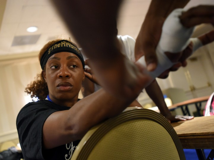 Franchon Crews has her hands wrapped while she waits for her match during the quarter final bouts at the Women's Olympic Trials Qualifier II held at the Baltimore Harbor Hotel.  (Lloyd Fox/Baltimore Sun)