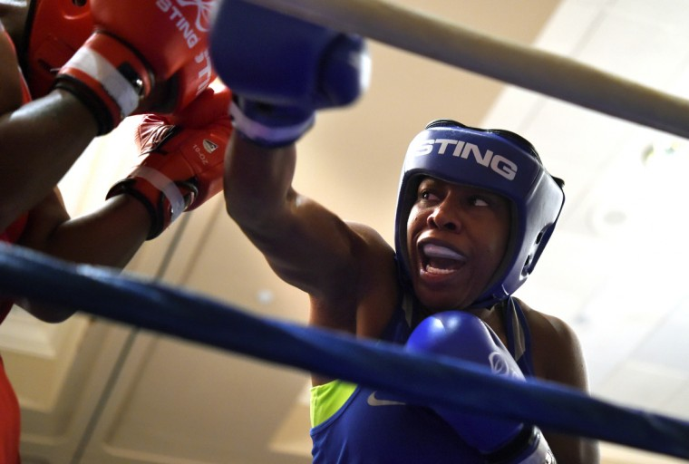 Franchon Crews, in blue, lands some punches as she battles Schmelle Baldwin of Wilmington,DE. during their quarter finals match at the Olympic Trials Qualifier II.     (Lloyd Fox/Baltimore Sun)