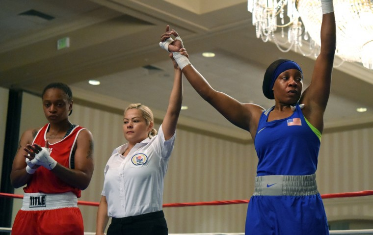 Franchon Crews, in blue, wins by TKO vs. Schmelle Baldwin of Wilmington,DE. during their quarter finals match at the Olympic Trials Qualifier II.  (Lloyd Fox/Baltimore Sun)