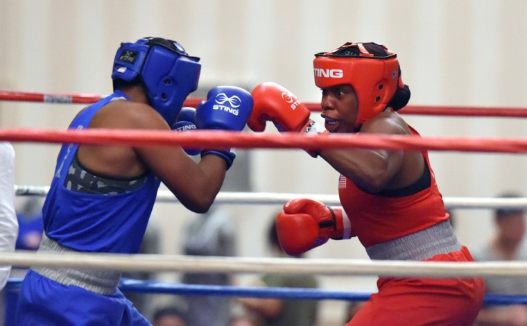 Franchon Crews, in red, boxes Lesha Kenney in the gold medal round of the Pathway to Glory Olympic Trials Qualifier II.  (Lloyd Fox/Baltimore Sun)