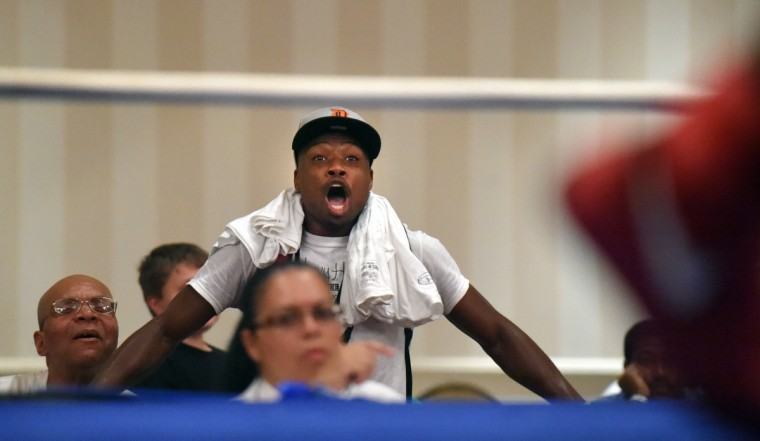 Glenn Dezurn Jr. cheers for his wife, Franchon Crews during her gold medal bout against Lesha Kenney in the Pathway to Glory Olympic Trials. (Lloyd Fox/Baltimore Sun)