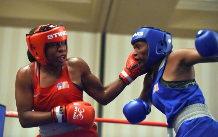 Franchon Crews, in red, lands a punch to the head of Lesha Kenney in the gold medal round of the Pathway to Glory Olympic Trials Qualifier II held at the Baltimore Harbor Hotel in Baltimore,Maryland. (Lloyd Fox/Baltimore Sun)