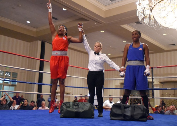 Franchon Crews, in red, celebrates her win over Lesha Kenney in the gold medal round of the Pathway to Glory Olympic Trials Qualifier II held at the Baltimore Harbor Hotel in Baltimore,Maryland. (Lloyd Fox/Baltimore Sun)
