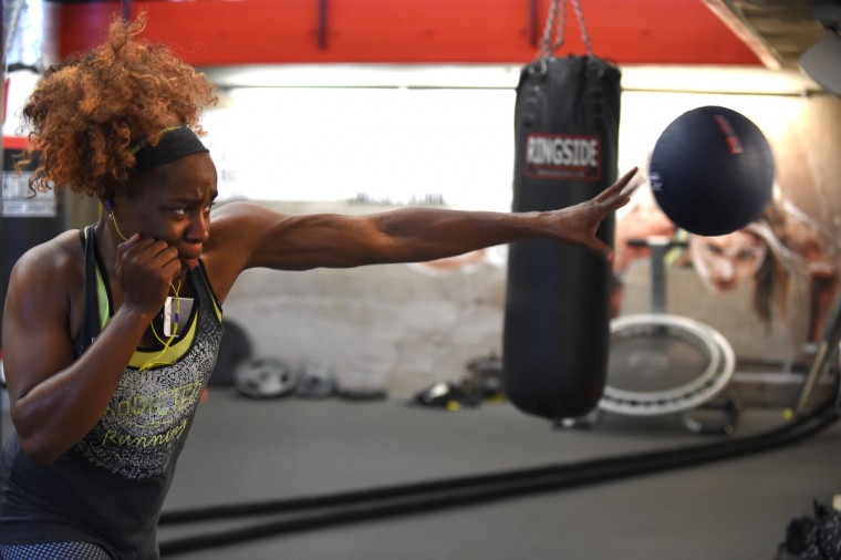 Franchon Crews uses a heavy ball while she practices throwing left handed punches in the gym as she prepares for the women's Olympic Qualifier II in Baltimore.  (Lloyd Fox/Baltimore Sun)