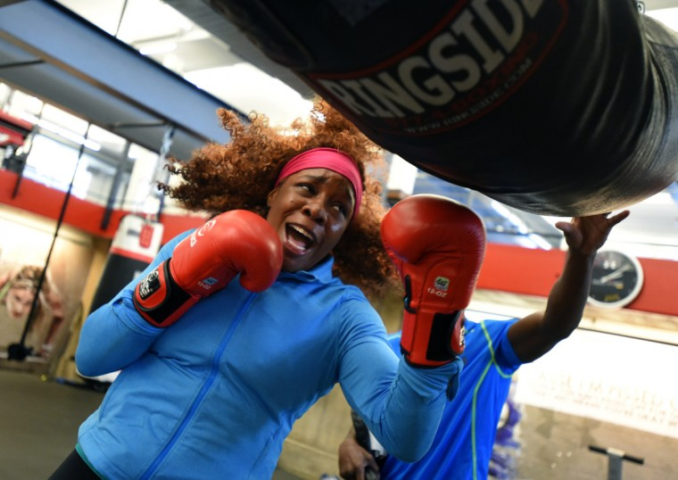 Franchon Crews hits the heavy bag at the Under Armour Performance Center while training for the Pathway to Glory Olympic Trials Qualifier II boxing event.  (Lloyd Fox/Baltimore Sun)