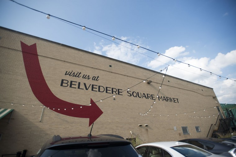 """Visit us at Belvedere Square Market"" is painted on a building right around the corner. (Emma Patti Harris/Baltimore Sun)"