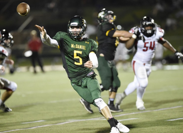 McDaniel quarterback Matty Callahan throws a pass during the first half of the Green Terror's season-opener against Catholic in Westminster Saturday, Sept. 5, 2015. (Dylan Slagle/Carroll County Times)