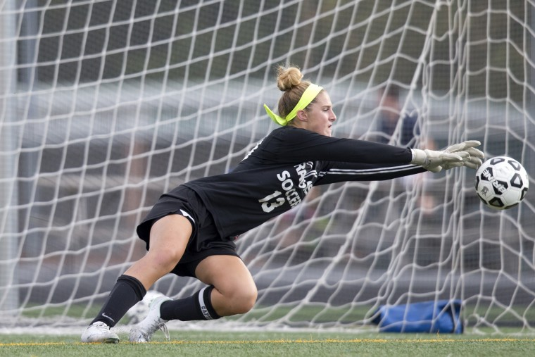 Atholton goalie Devon Bodziony makes a save during the girls soccer game against Howard at Atholton High School in Columbia, MD on Wednesday, September 9, 2015. (Jen Rynda/BSMG)