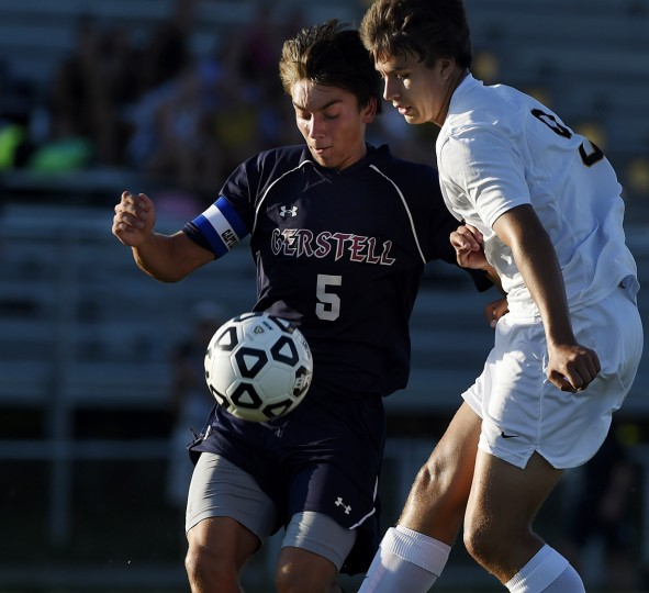 Gerstell's Luke Gardner fand South Carroll's Nicko Lindsay fight for the ball Tuesday, Sept. 8 at South Carroll High School. (Dave Munch/Carroll County Times)