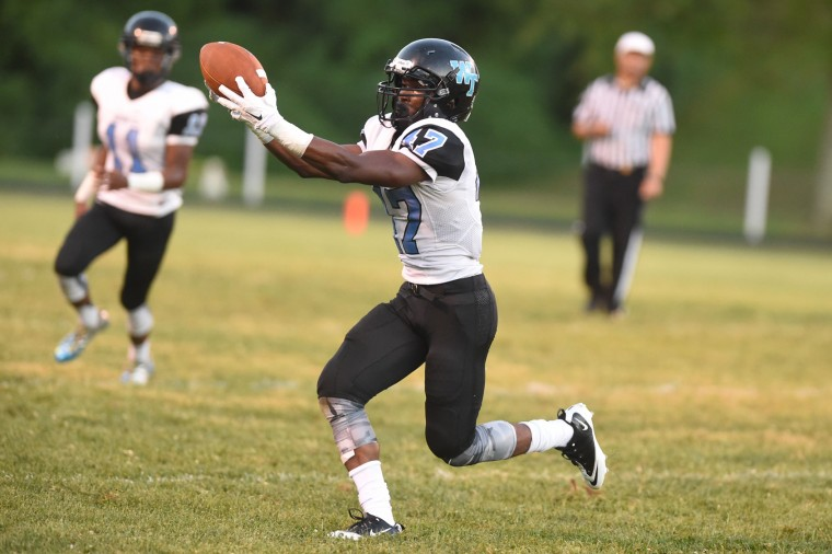 Western Tech's Harmony Obasi reaches out to make a reception during a football game at Loch Raven High School on Friday, Sept. 11. (Brian Krista/BSMG)