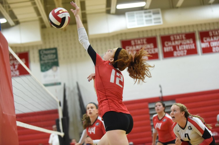 Glenelg's Corinne Conover makes an attempt at a kill during a volleyball game against River Hill at Glenelg High School on Thursday, Sept. 10. (Brian Krista/BSMG)