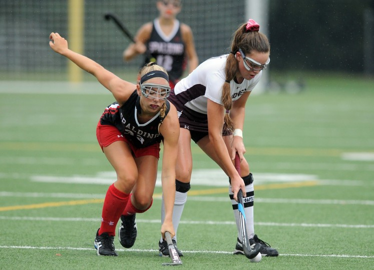 Broadneck's Ena Belch, right, keeps the ball from Spalding's Caroline Caruso in the first half. The visiting Archbishop Spalding Cavaliers defeated the Broadneck Burins, 5-0, in girls high school field hockey Saturday morning. (Paul W. Gillespie/Capital Gazette)