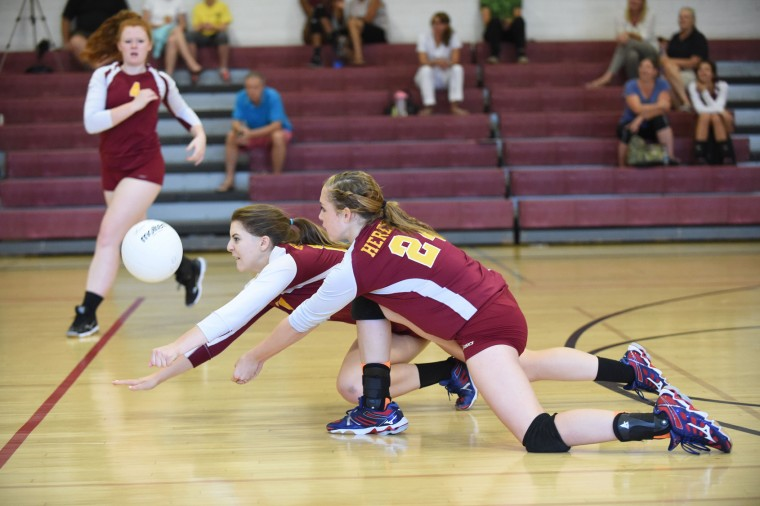 Erin Collins, left, dives in front of her Hereford teammate Sabrina Bradford to make a play on the ball during a volleyball match at Towson High School on Tuesday, Sept. 14. (Brian Krista/BSMG)