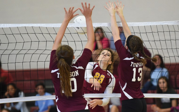 Hereford's Erin Collins has a shot stopped by a block from Towson's Sara Mandreja, left, and Maeve O'Connor during a volleyball match at Towson High School on Tuesday, Sept. 14. (Brian Krista/BSMG)