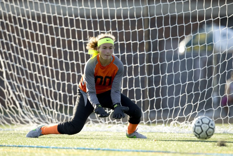 Wilde Lake goalie Jenna Hutchison gets down to make the save during the girls soccer game against Howard at Wilde Lake High School in Columbia, MD on Tuesday, September 15, 2015. (Jen Rynda/BSMG)