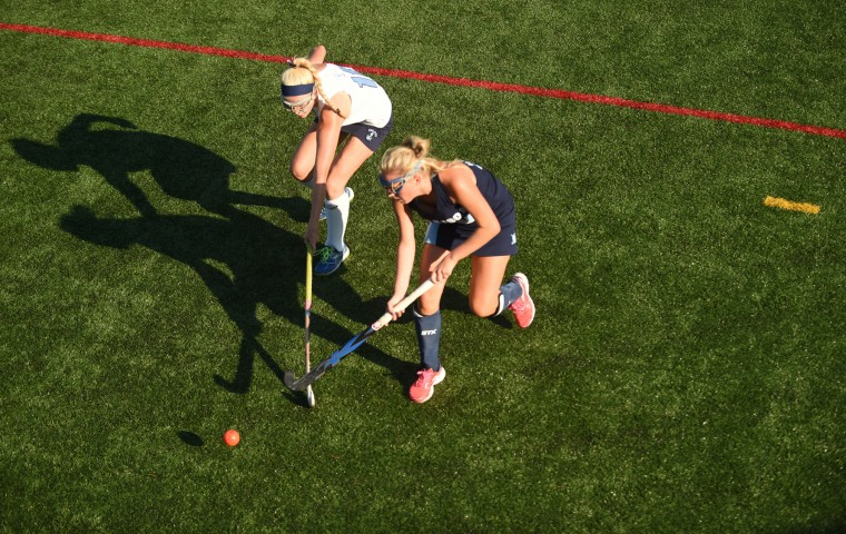Garrison Forest's Meg Swindell, right, hits the ball in the direction of the sidelines away from Mount de Sales' Peyton Taylor during an IAAM A Conference field hockey game at Mount de Sales Academy in Catonsville on Wednesday, Sept. 16. (Brian Krista/BSMG)