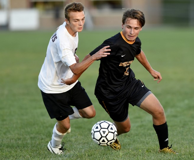 South Carroll's Ryan Rosenthal fights upfield in front of  Winters Mill's Kyle Golden Tuesday, Sept. 15 in Westminster. (Dave Munch/Carroll County Times)