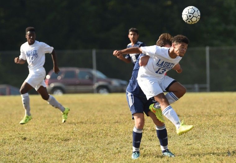 Laurel's Spencer McPherson makes a play on the ball with his head during a boys soccer game against Northwestern at Laurel High School on Thursday, Sept. 17. (Brian Krista/BSMG)