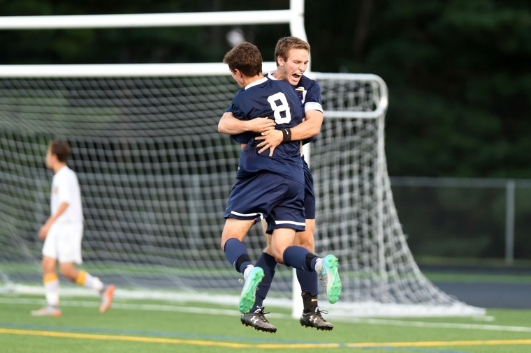 River Hill's Luke Turney embraces teammate Chris Berhrman (8) as they celebrate a game-tying goal in the second half during a boys soccer game at Mt. Hebron High School in Ellicott City on Thursday, Sept. 17. (Brian Krista/BSMG)