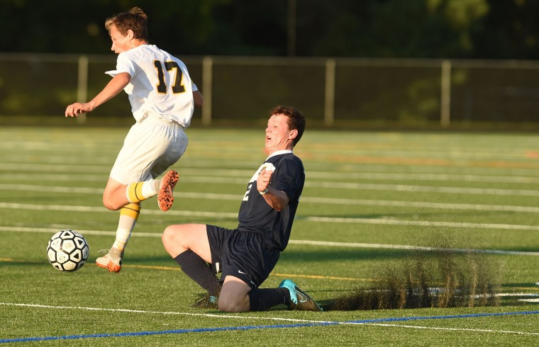 Mt. Hebron's Michael Yacynich, left, and River Hill's Mike Heitzmann nearly collide while both making a play on the ball during a boys soccer game at Mt. Hebron High School in Ellicott City on Thursday, Sept. 17. (Brian Krista/BSMG)