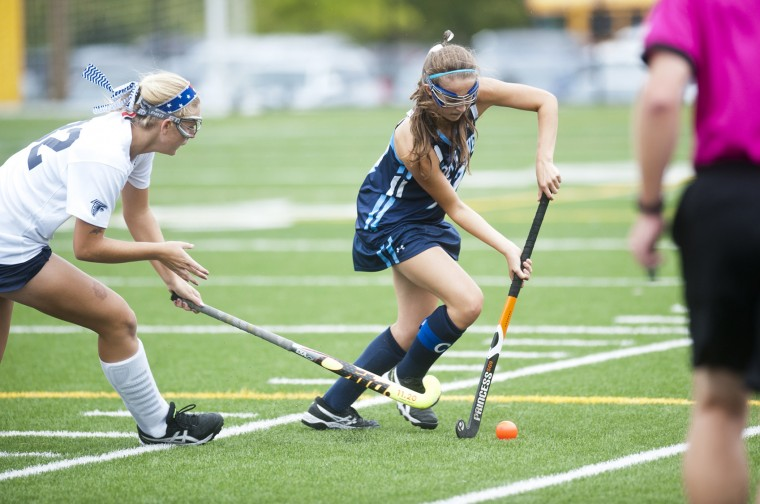 Severna Park's Rachel Lewis and  and South River's Sarah King play in the field hockey game at Kinder Farm Park. (Joshua McKerrow/Capital Gazette)