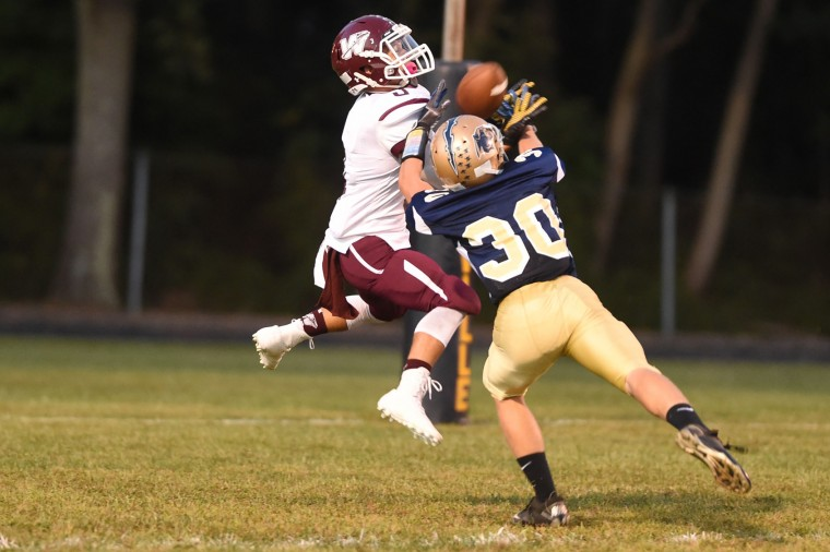 Havre de Grace receiver Chris Harris makes a catch over Perryville defender Chris Wenck (30) in the endzone for a first quarter score during a football game at Perryville High School on Friday, Sept. 18. (Brian Krista/BSMG)