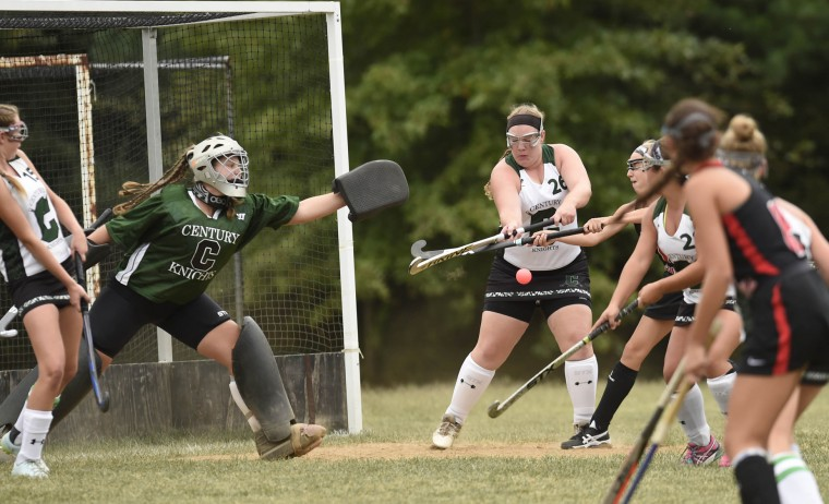 Century goalkeeper Catie Pluta, left, protects the goal during their 4-0 loss to North Carroll in Eldersburg Monday, Sept. 21, 2015. (Dylan Slagle/Carroll County Times)