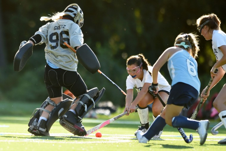 Notre Dame Prep's Marissa Firlie tries to get a shot past Mount de Sales goalie Olivia Gretz during a field hockey game at Notre Dame Prep in Towson on Wednesday, Sept. 23. (Brian Krista/BSMG)
