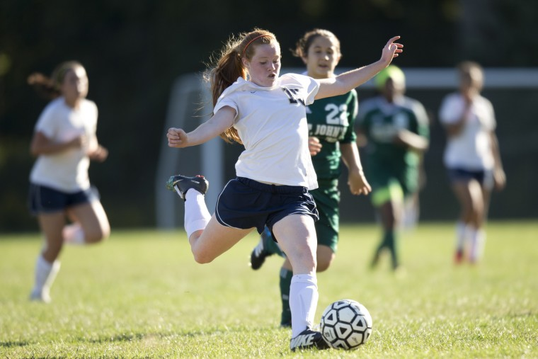 Chapelgate's Megan Donnelly looks to make a long pass during the girls soccer game against St. John's at Chapelgate Christian Academy in Marriottsville, MD on Wednesday, September 23, 2015. (Jen Rynda/BSMG)
